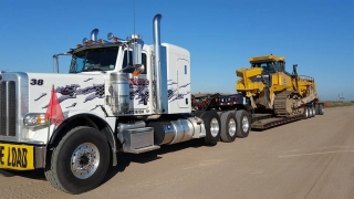 Crockett's truck transporting equipment