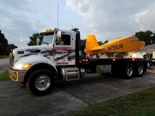 Crockett's truck transporting a Piper cub