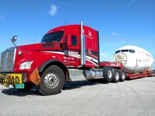 Kauff's truck transporting airplane fuselage