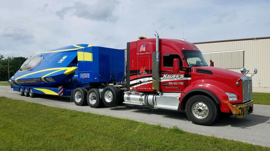 Kauff's truck transporting raced boat